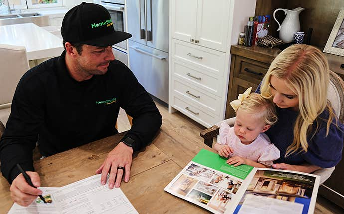 a service professional with a homeowner and child