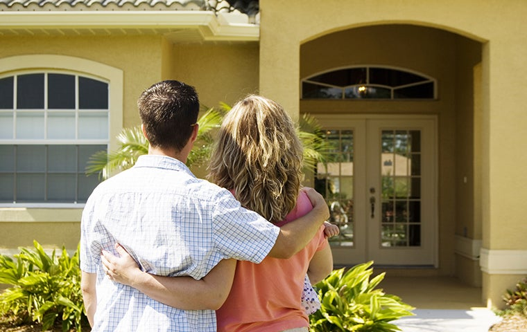 two homeowners looking at the front of their san diego house
