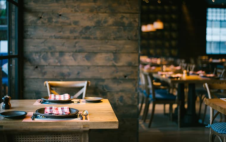 a rustic restaurant with empty tables