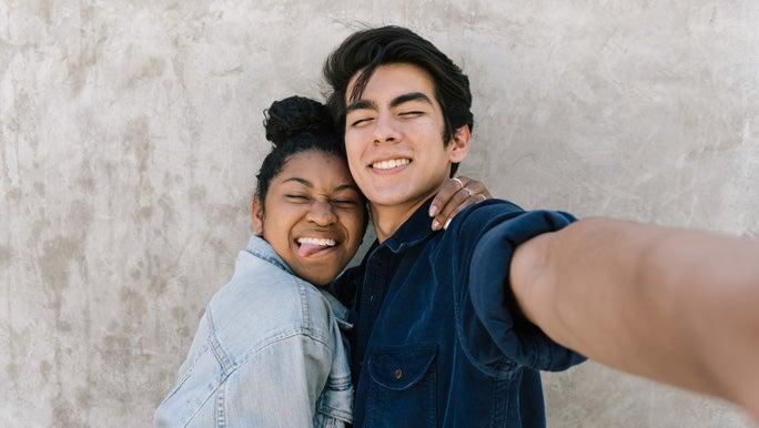 Teenage couple taking a selfie