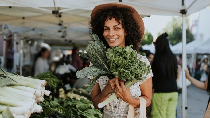 image of women with organic green vegetables