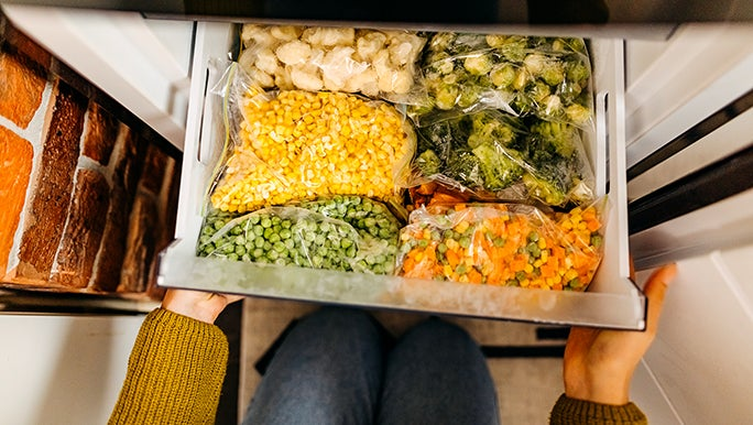 From above, a freezer drawer is filled to the brim with 20+ serves of vegetables.