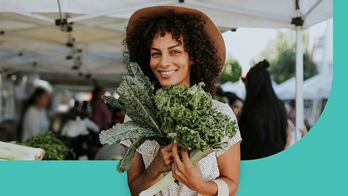Woman at the farmers market buying green vegetables
