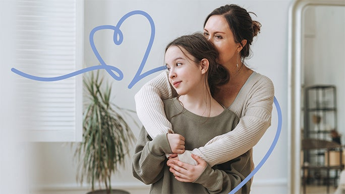 Mother with her arms around her young teenage daughter