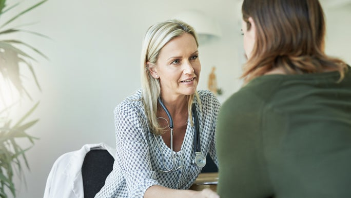 Woman having a consultation with her female GP