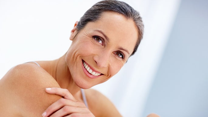Smiling mature woman with clean fresh skin