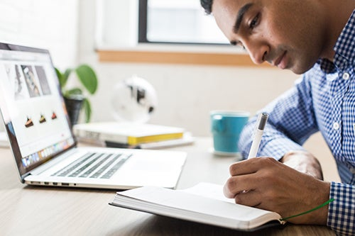 Man studying with a laptop