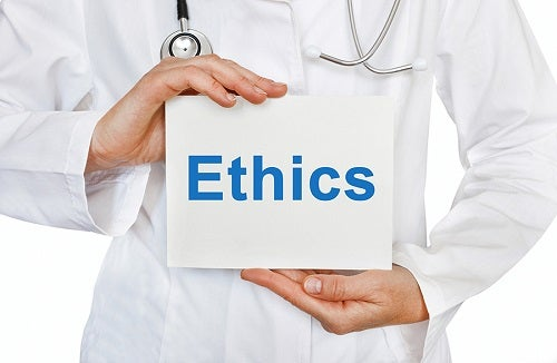 Medical professional with Ethics placard