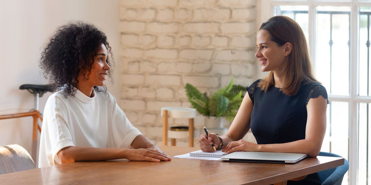 an employer interviewing a potential job candidate