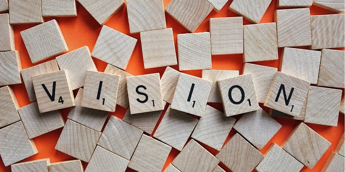 Scrabble tiles that spell the word VISION