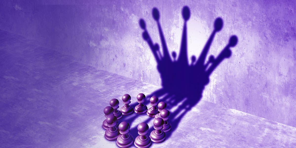 chess pieces projecting the shadow of a crown