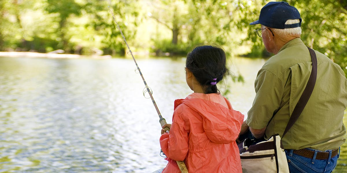 grandfather teaching granddaughter to fish, taking ownership of learning