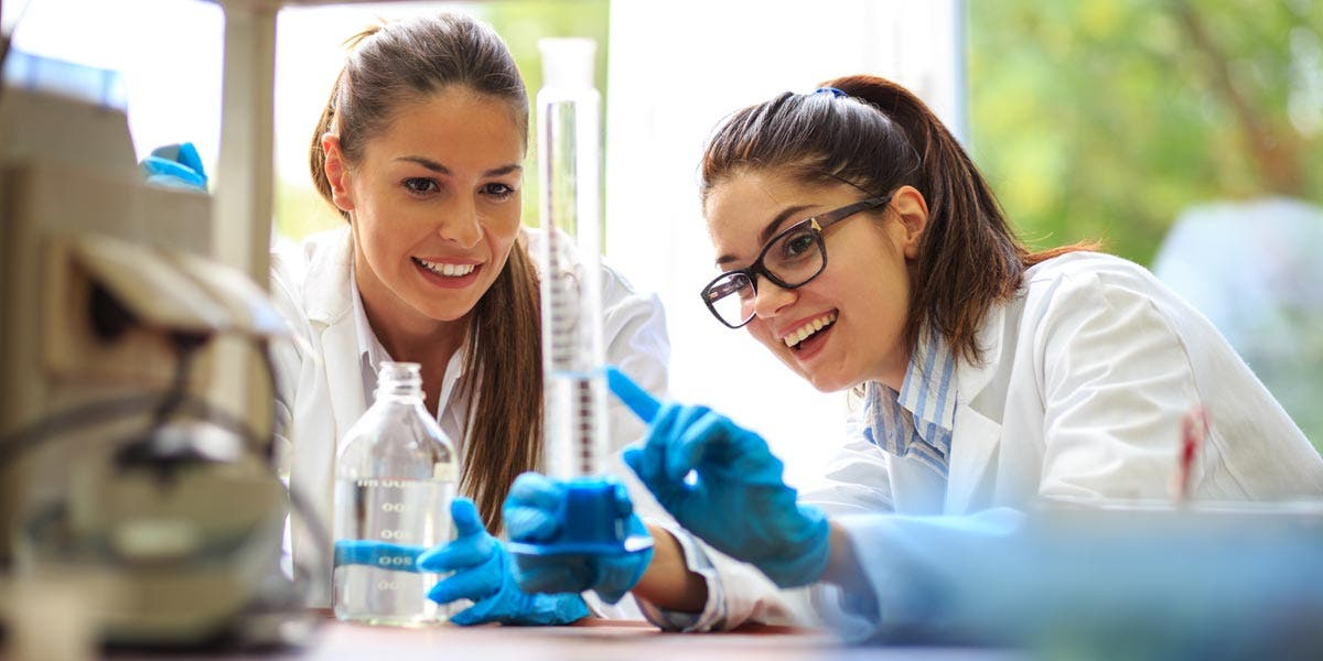 Two women scientists working together in a chemistry lab