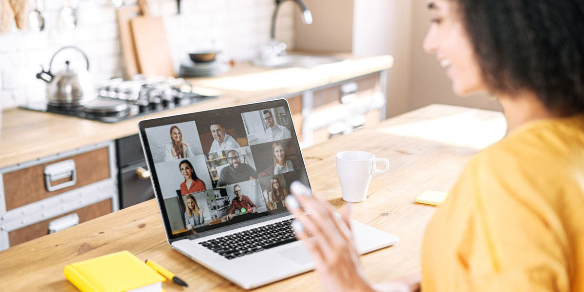 female holding a virtual meeting with her team