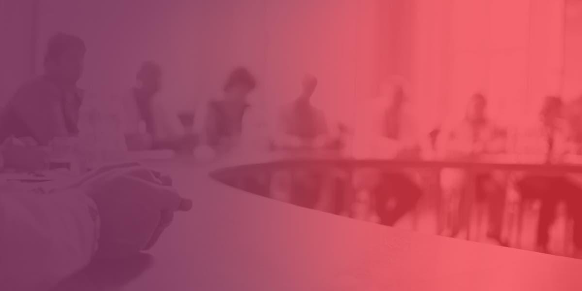 executives at a board table