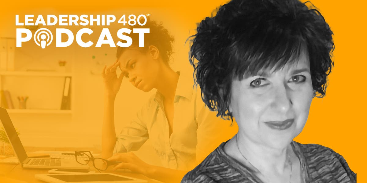 photo of Dr. Geri Puleo with a woman leader in the background looking stressed out as she works on her laptop in the background to show that this leadership 480 podcast episode is about women and burnout in leadership