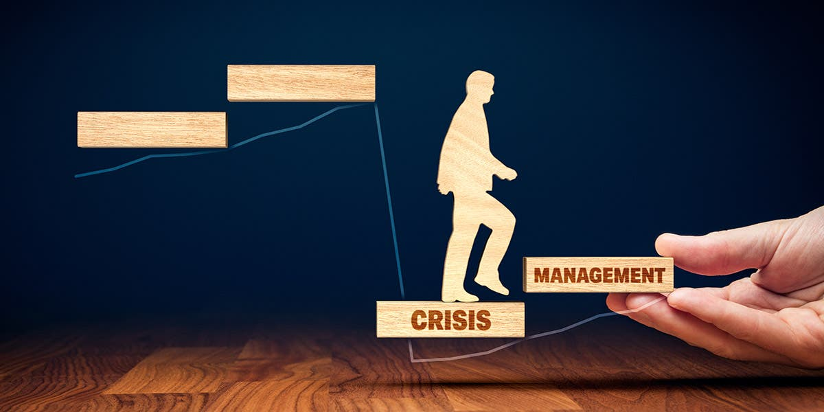 """Illustration of a man walking across wooden steps that say """"crisis management"""" to show business transformation after a crisis"""