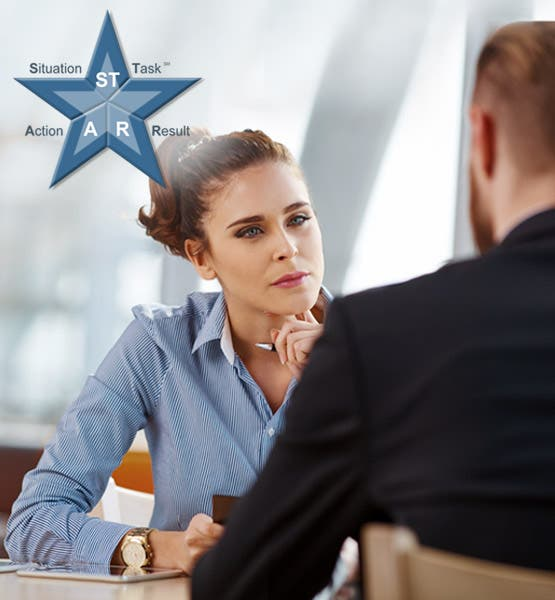 woman speaking to a man with the STAR method with the letters 's' 't' 'a' and 'r' positioned across a star shape?auto=format&q=75
