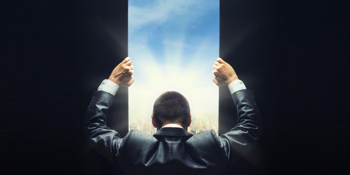 Man opening door to see future of leadership development