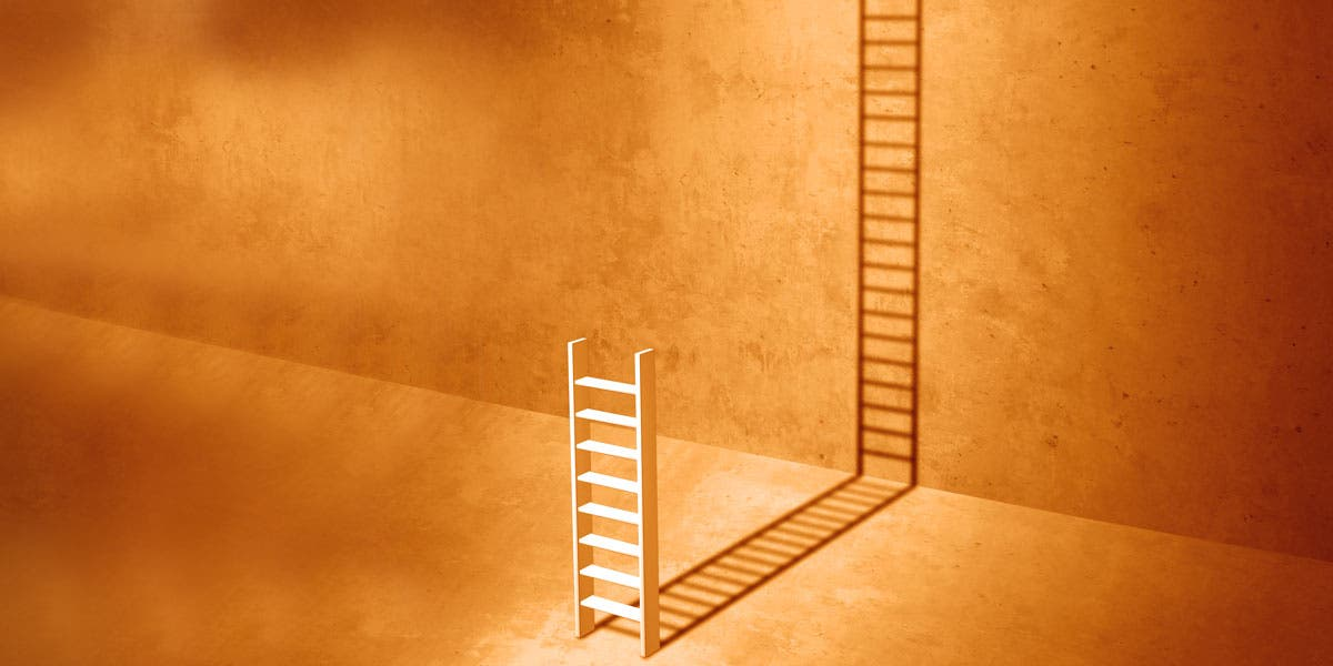 a ladder projecting the shadow of a bigger ladder