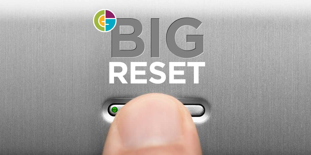 finger pressing the reset button