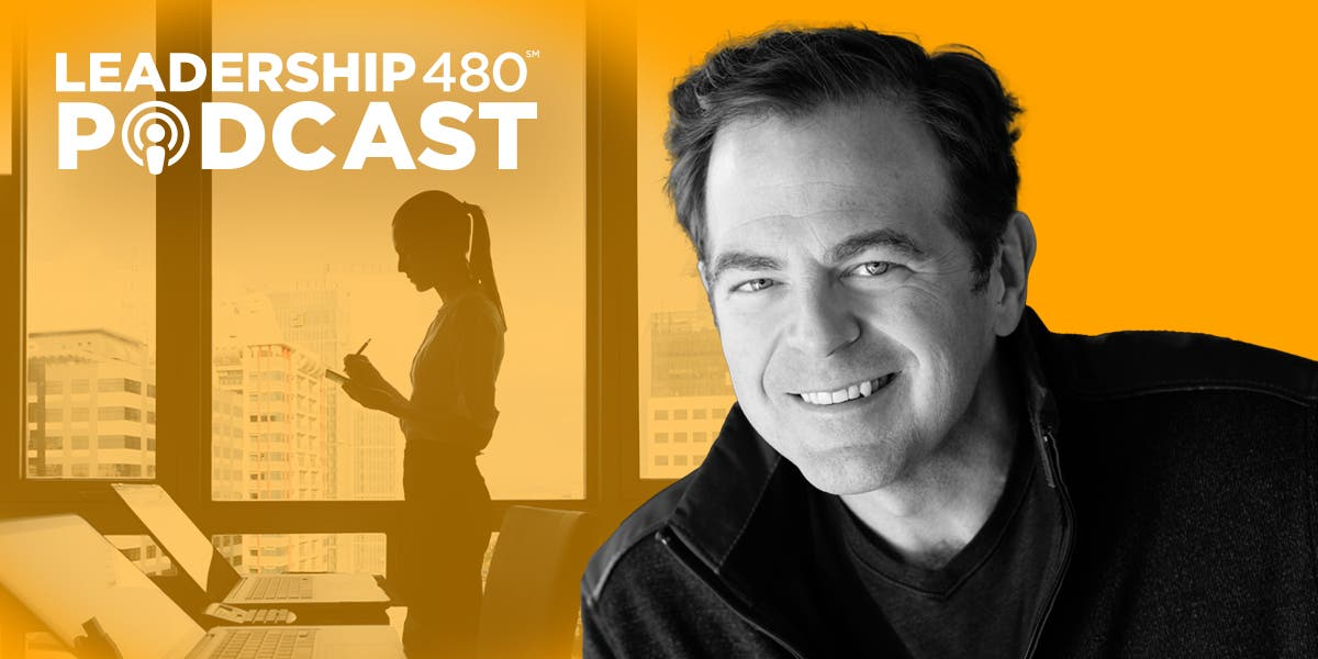 headshot of author Dr. Kevin Fleming with image of woman leader standing in an office building overlooking skyscrapers to represent mental health in the workplace in this episode of the Leadership 480 podcast