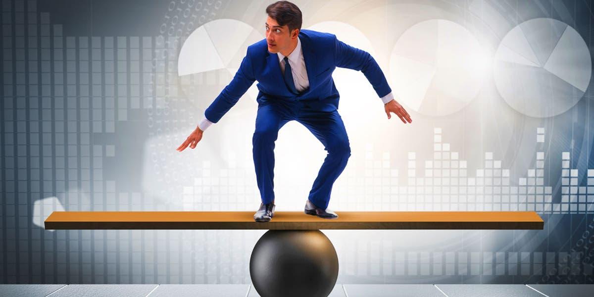 man balancing on a board