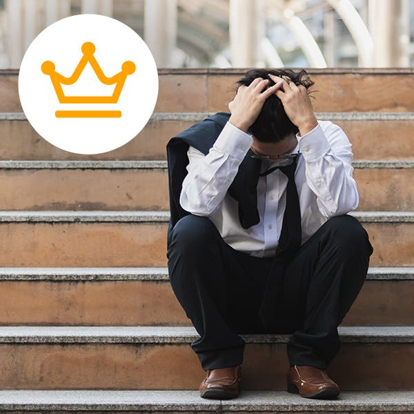 Man sitting on step upset?auto=format&q=75