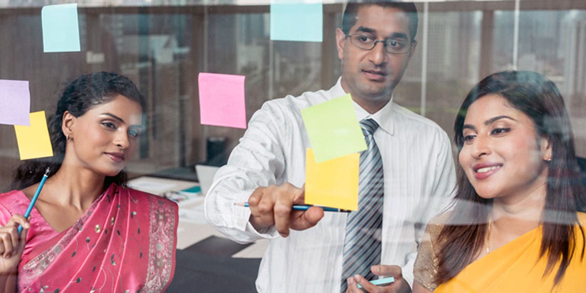 people looking at post-its
