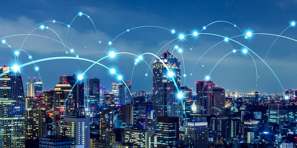 city at night with illustration of arcs between buildings depicting virtual connections