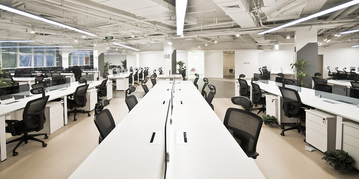empty office space after workers pivoted to a virtual workplace