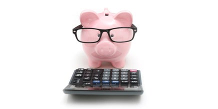 a piggy bank and calculator
