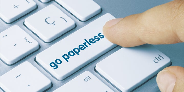 go paperless button on a keyboard