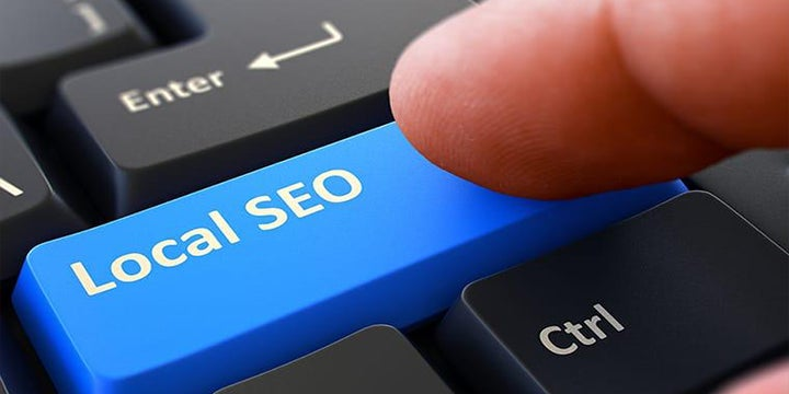 person pressing local seo button on keyboard