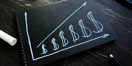money symbols on a notepad
