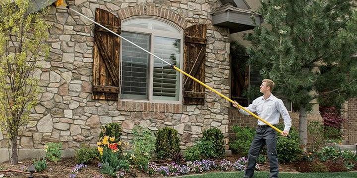 a technician dewebbing a home