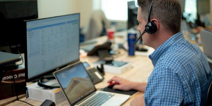 a customer service technician on the phone