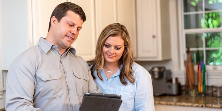 technician showing a homeowner software