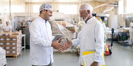 a technician shaking hands with a client