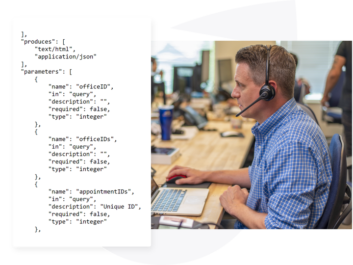 man looking at code on computer
