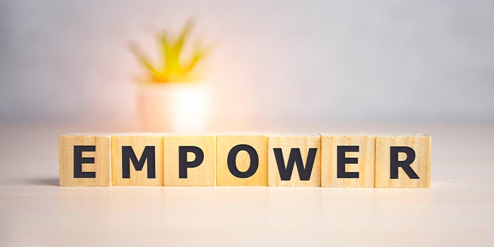 the word empower spelled out in blocks