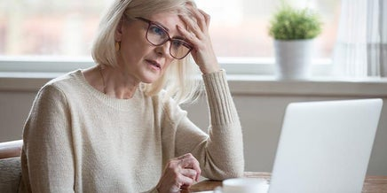 a frustrated elderly woman