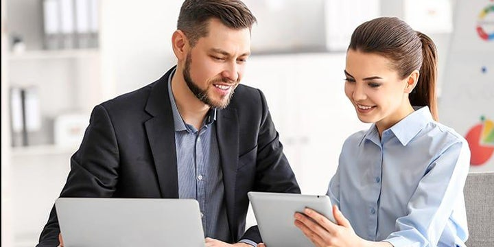 business people reviewing tablet
