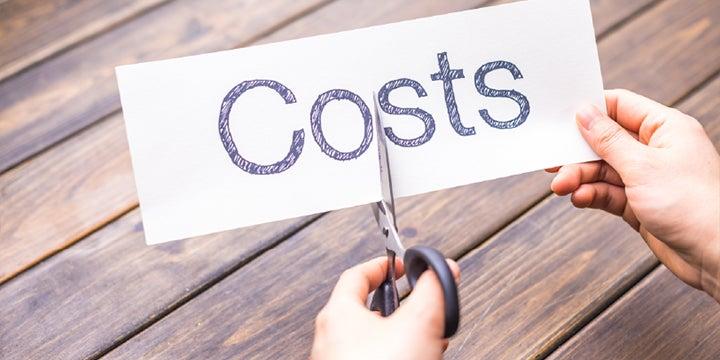scissors cutting the costs