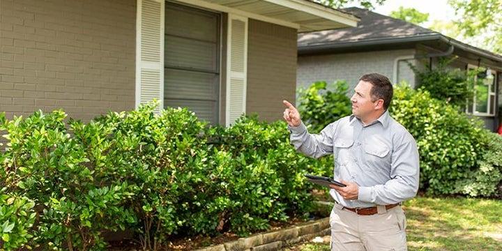 a tech inspecting a home