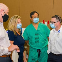 Baptist Health Care team members with masks discussing mock up day.