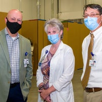 Scott Raynes, Cynde Gamache and Dr. Glisson wearing masks posing for picture.