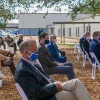 Invited guests at Baptist Health Care new campus groundbreaking listening to speaker