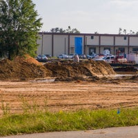 View of leveled ground with building beyond area.