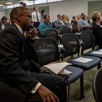 Attendees of press conference listen to new Baptist Hospital announcement